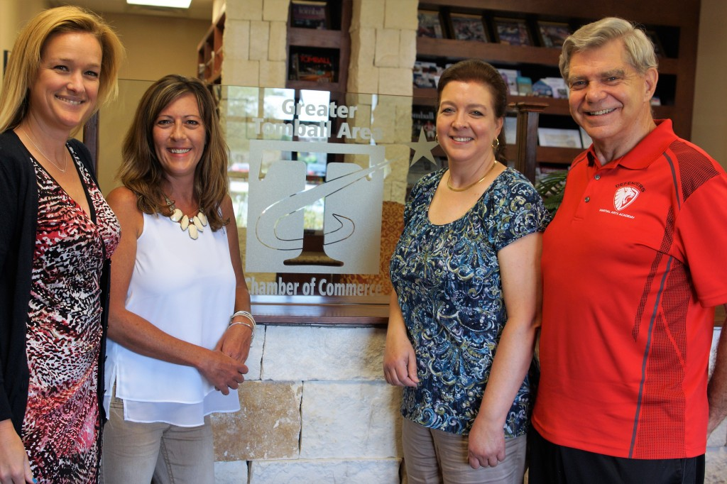 Left to Right:  Chamber Leaders Amy Mason - Communications and Dawn Stone - Community Relations, with Defenders Stacy Hunt - Operations Manager and Gordon Scheele - Founder